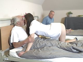 Young nurse Nana Garnet is sucking hard dicks of two pensioners