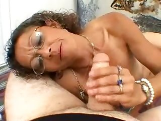 Nerdy curly lay whore is so into jerking off stiff dick