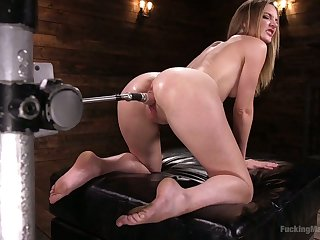 Oiled all over bitch Mona Wales gets her pussy slammed with crazy fucking equipment