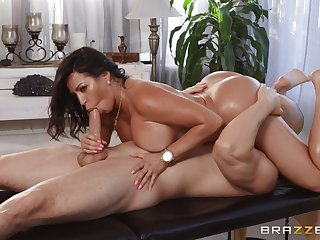 Tanned woman rides the masseur's huge dick