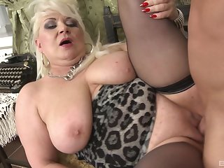 Chunky mature plays up the young dick in A- scenes