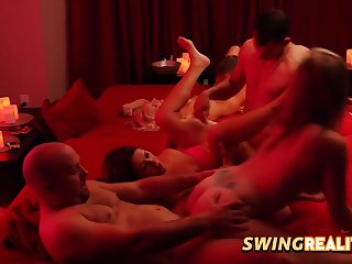 Swinger couples are having a wild orgy