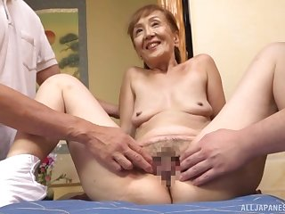 A remarkable threesome Japanese play with a sexy granny