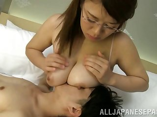 Asian nymph involving glasses gives a tasty cock an grown titjob involving POV